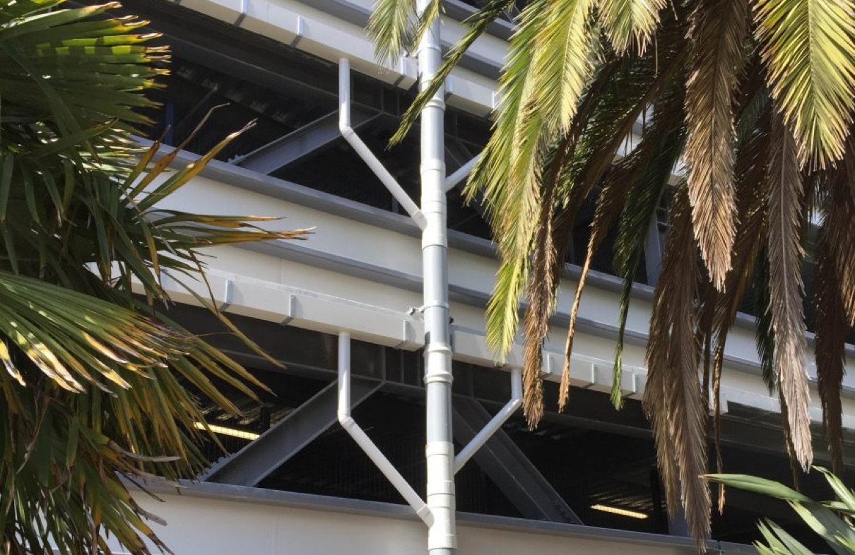 The outside of car parking building with exposed pipes