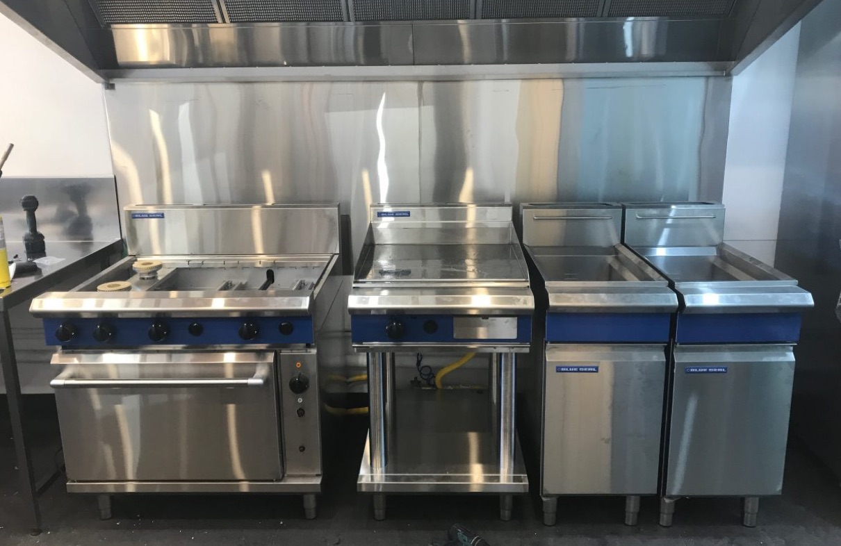 A large commercial gas range for gas fitting
